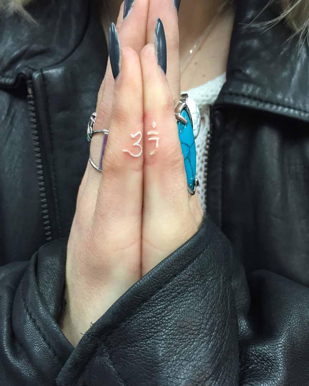 White Hindu Finger Tattoos by brittholdthebrat