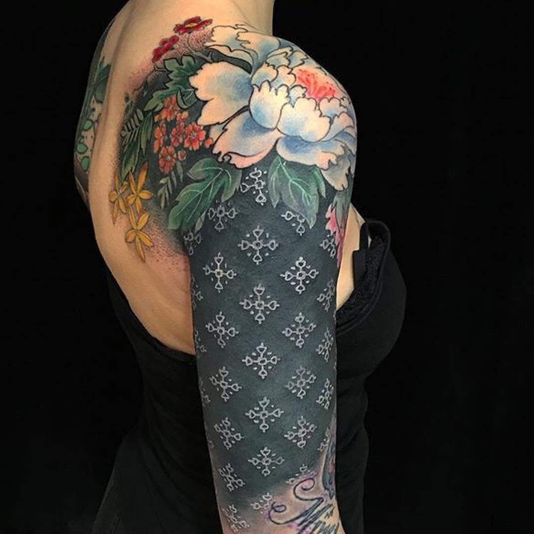 White Tattoo Ink on Black Skin by @butterfatstudios