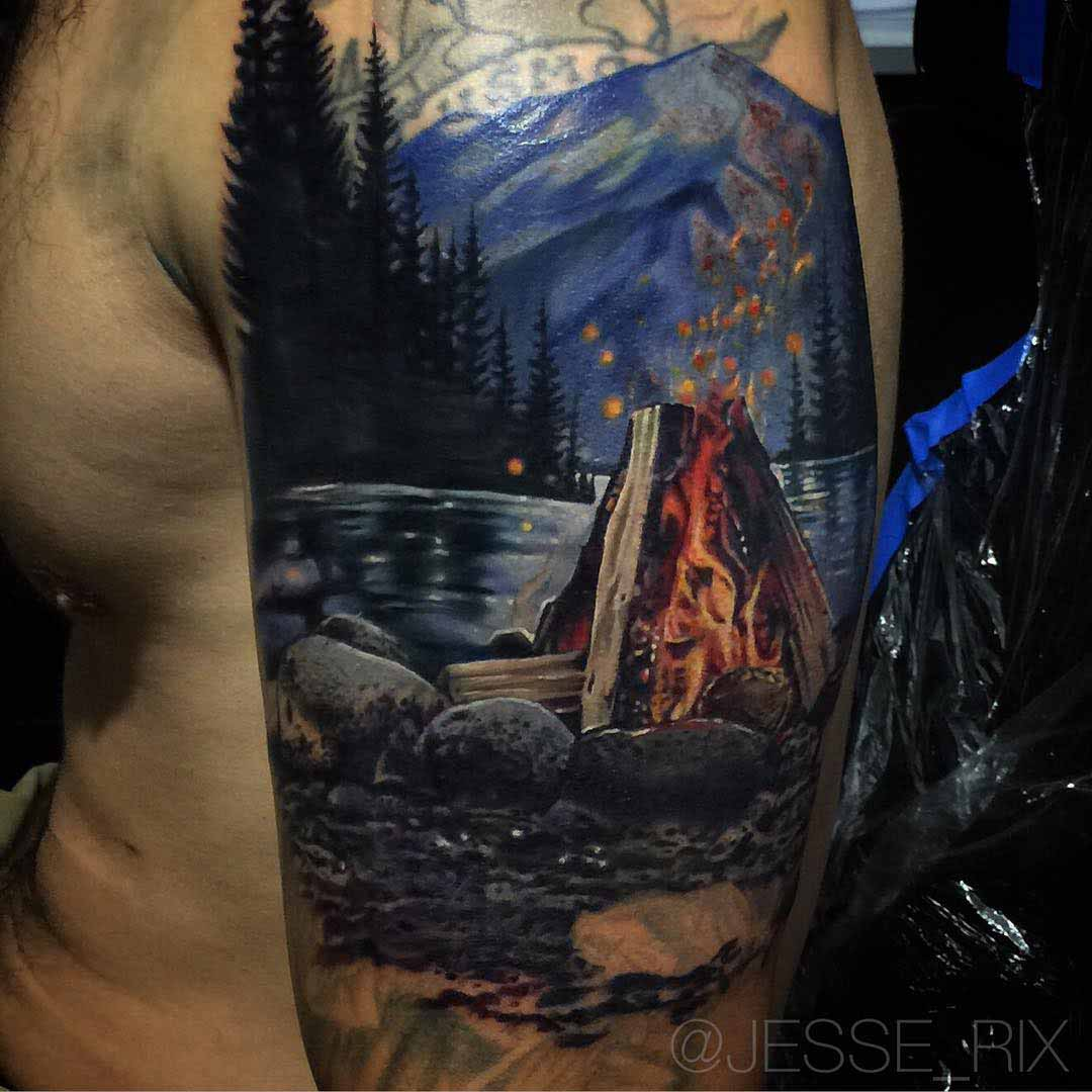 shoulder cover-up tattoo campfire