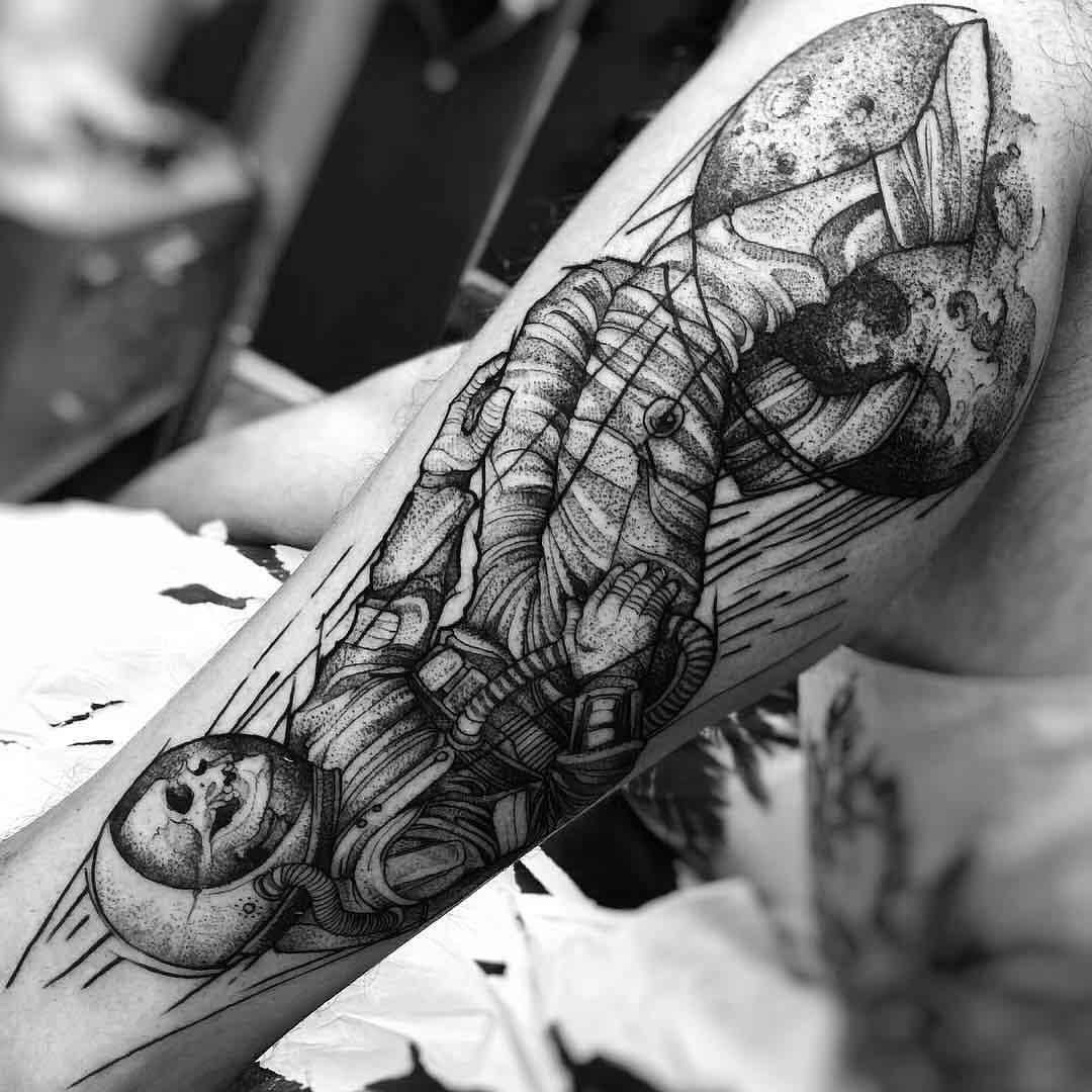leg tattoo dotwork astronaut
