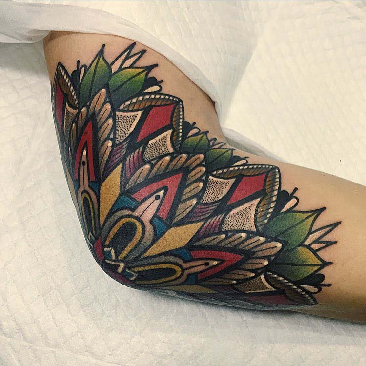 neo-traditional tattoo on elbow