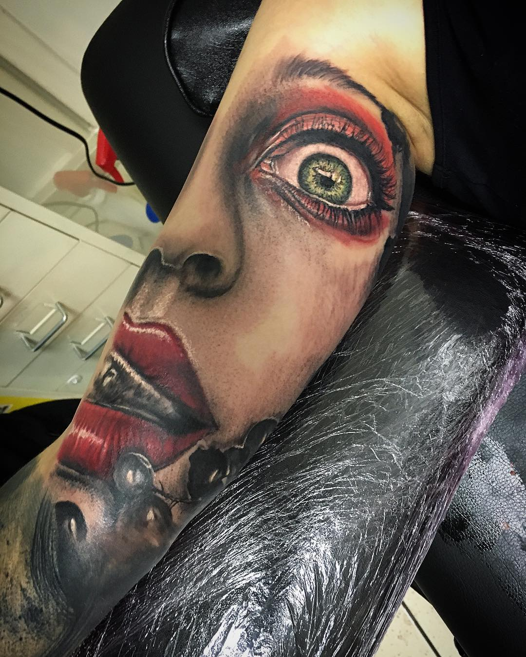 Crazy Face tattoo on bicep