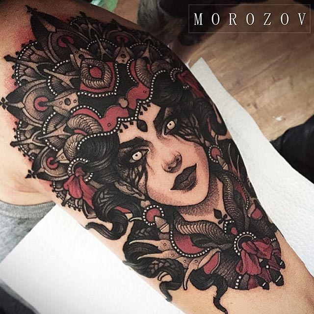 neo-traditional girl face tattoo on shoulder