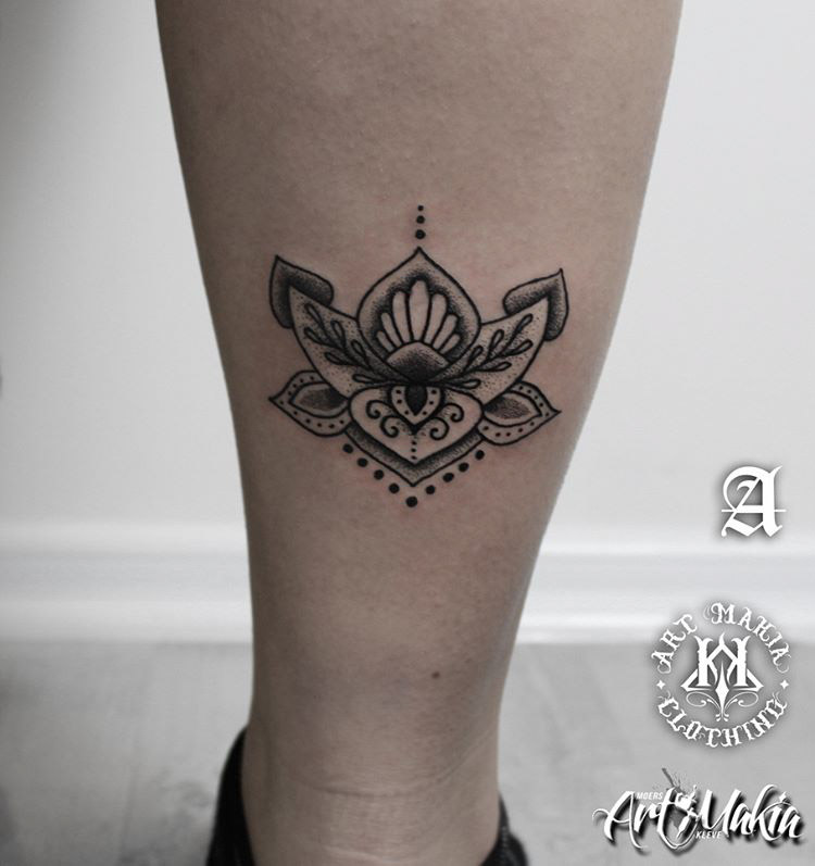 eastern themed lotus flower tattoo on leg