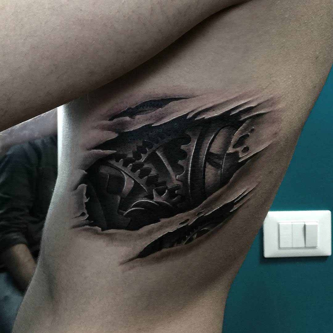 cogwheels tattoo biomechanical on ribs side