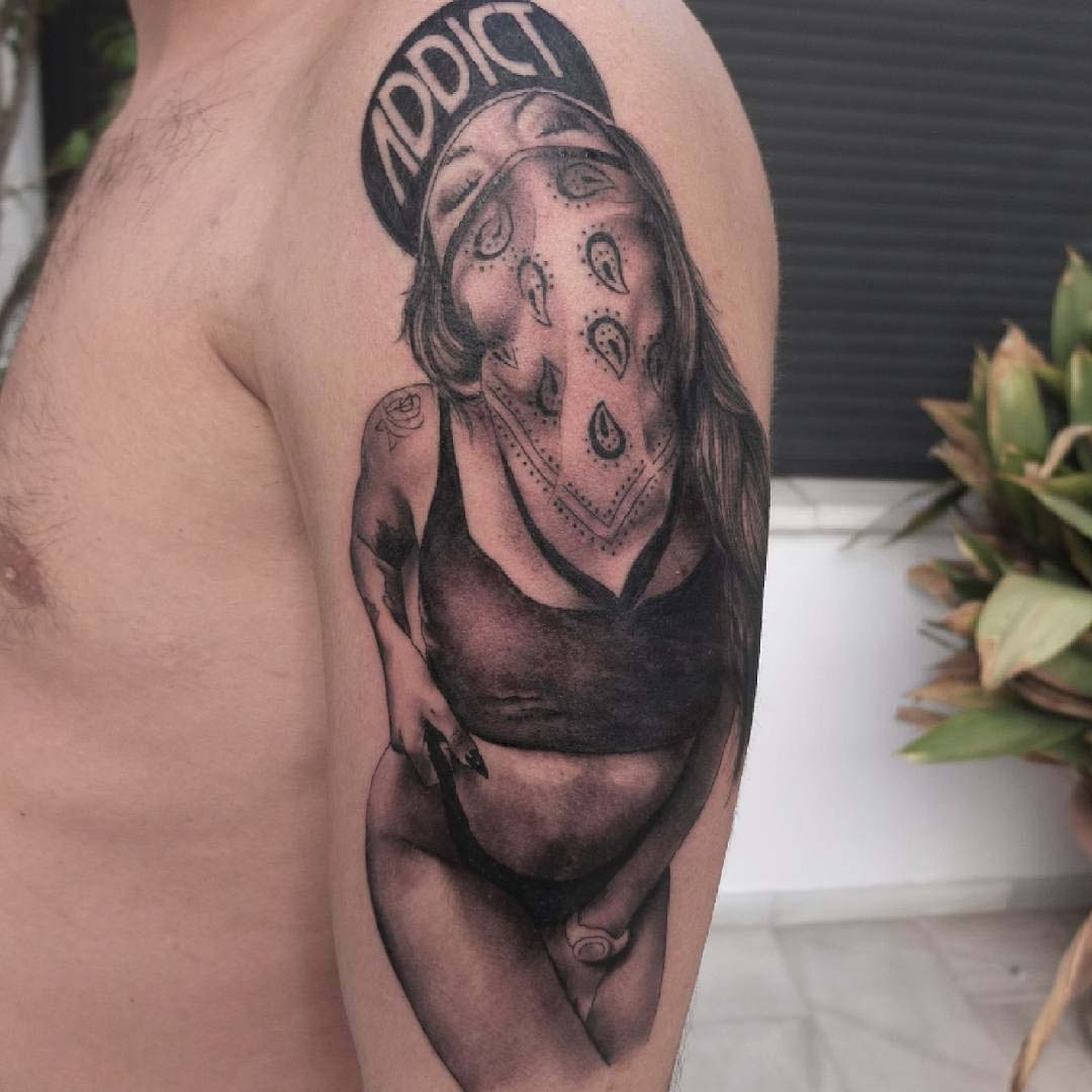 chicano girl tattoo on shoulder