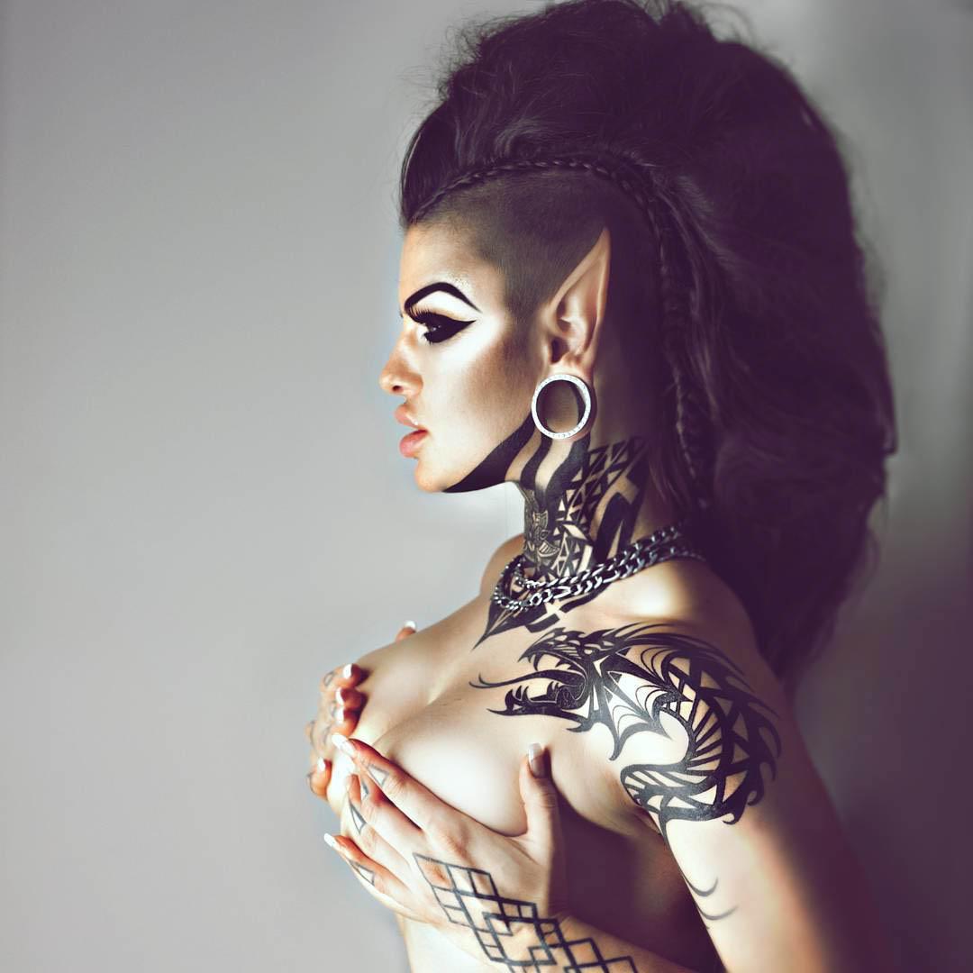 girl tribal tattoo on neck