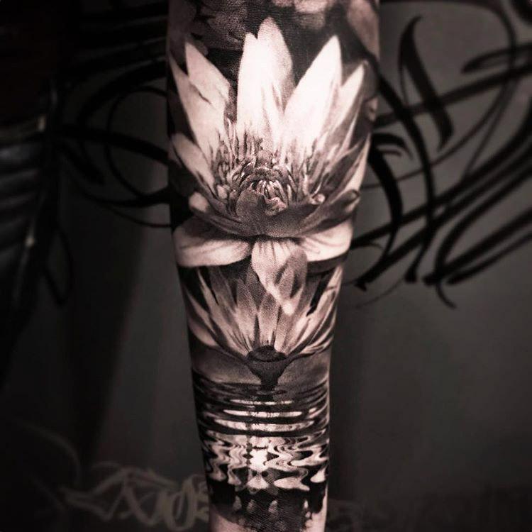 Lotus flower tattoo eD sleeve on arm