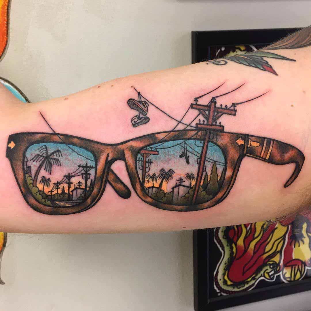 neo-traditional glasses tattoo on bicep
