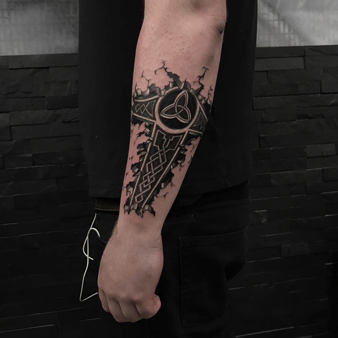 hummer triquerta sign celtic tattoo on forearm
