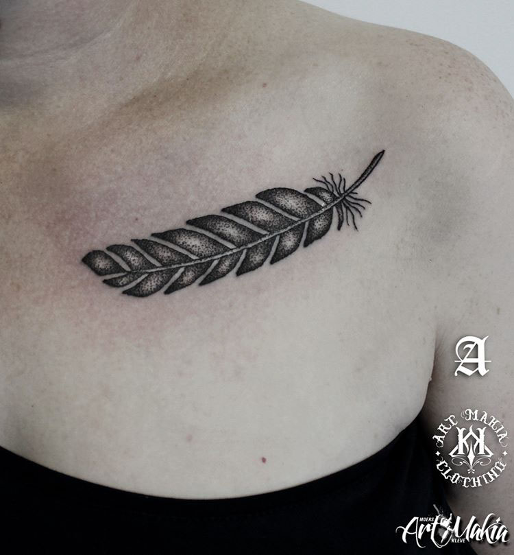 collar bone tattoo of feather