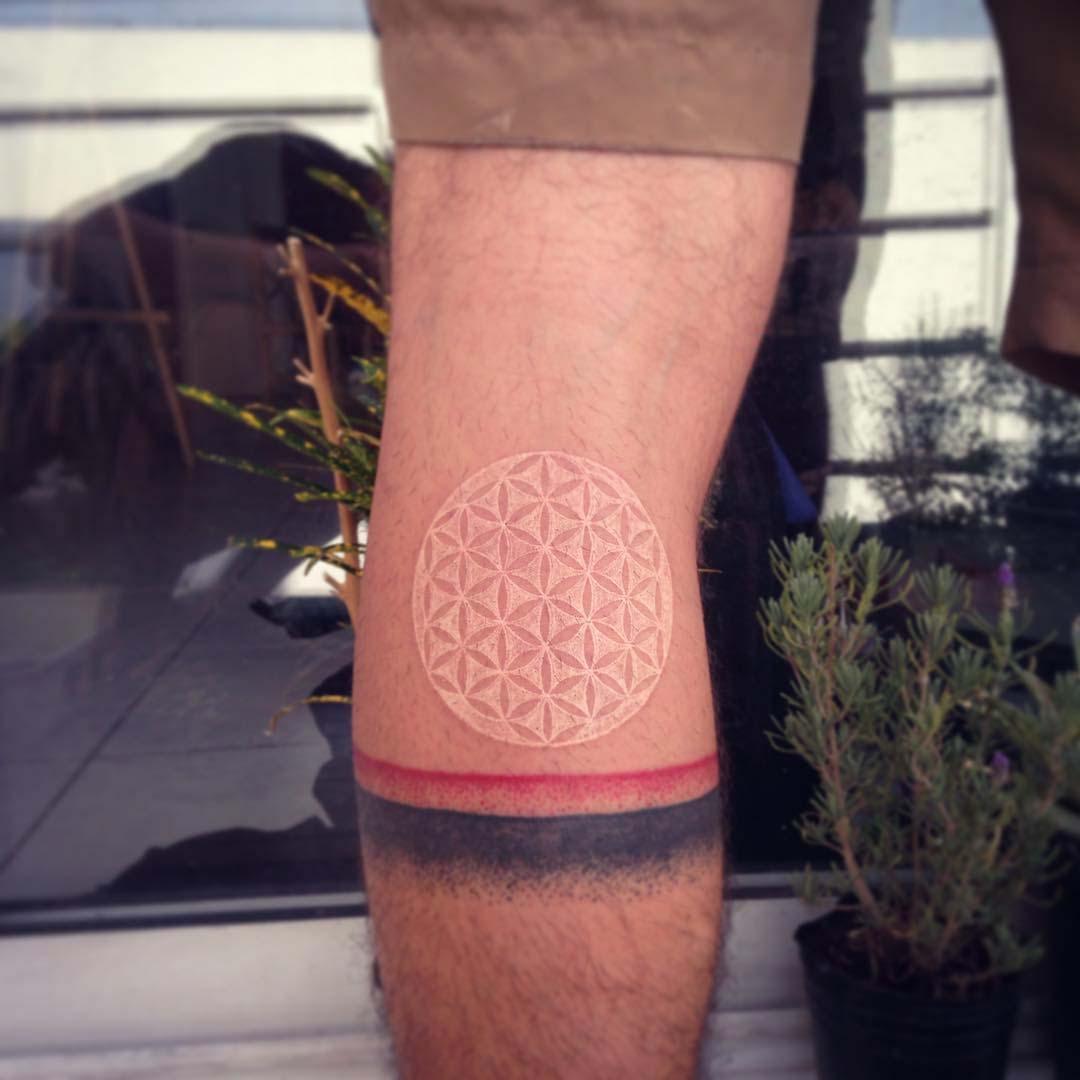 back knee white tattoo pattern