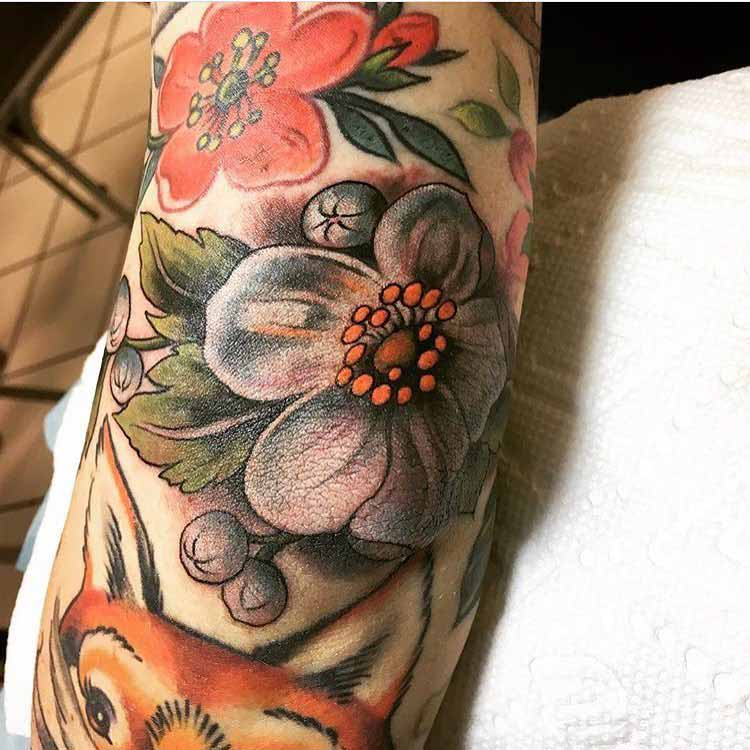 flower tattoo on elbow realistic style