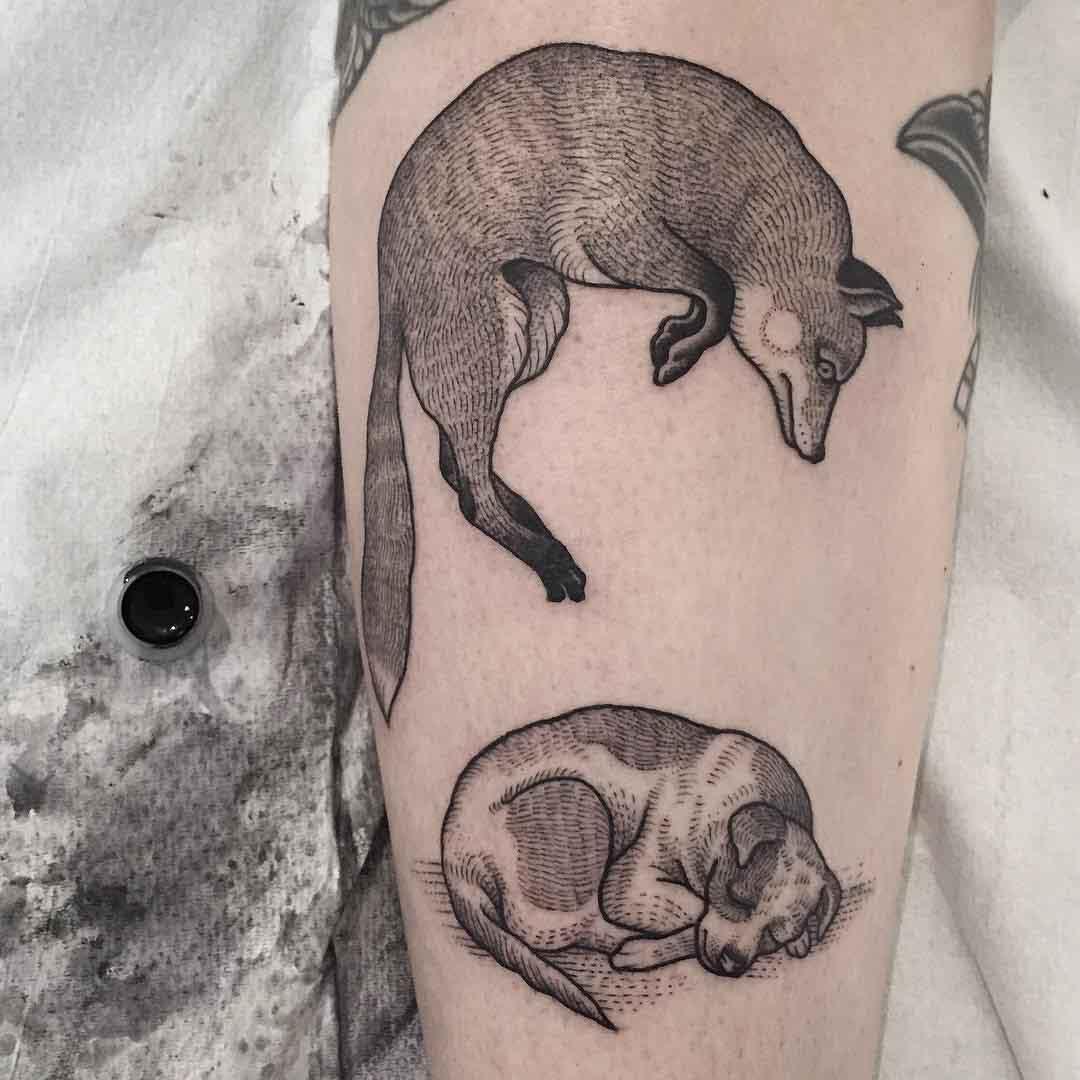 fox and hound tattoo on arm
