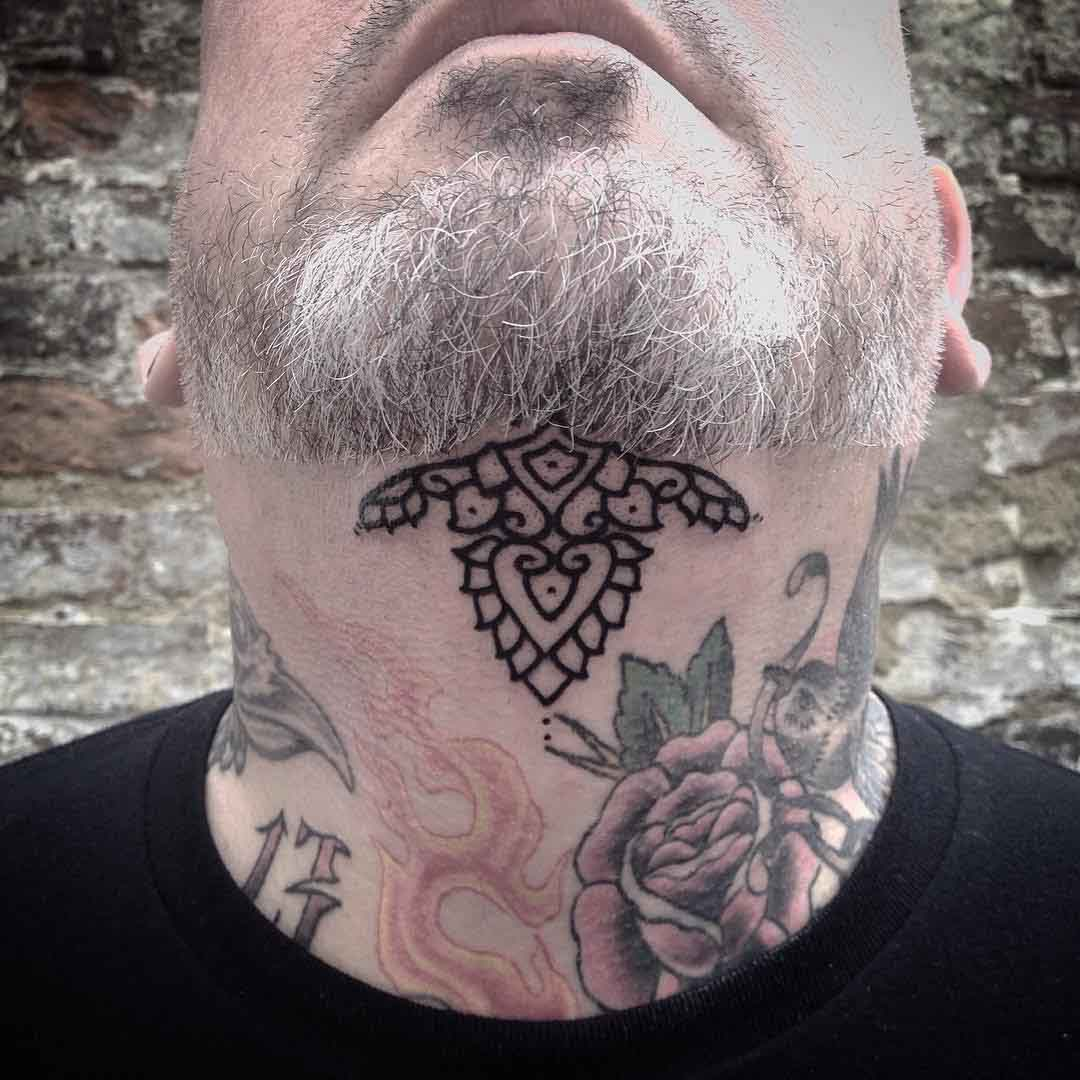 simple tattoo under chin