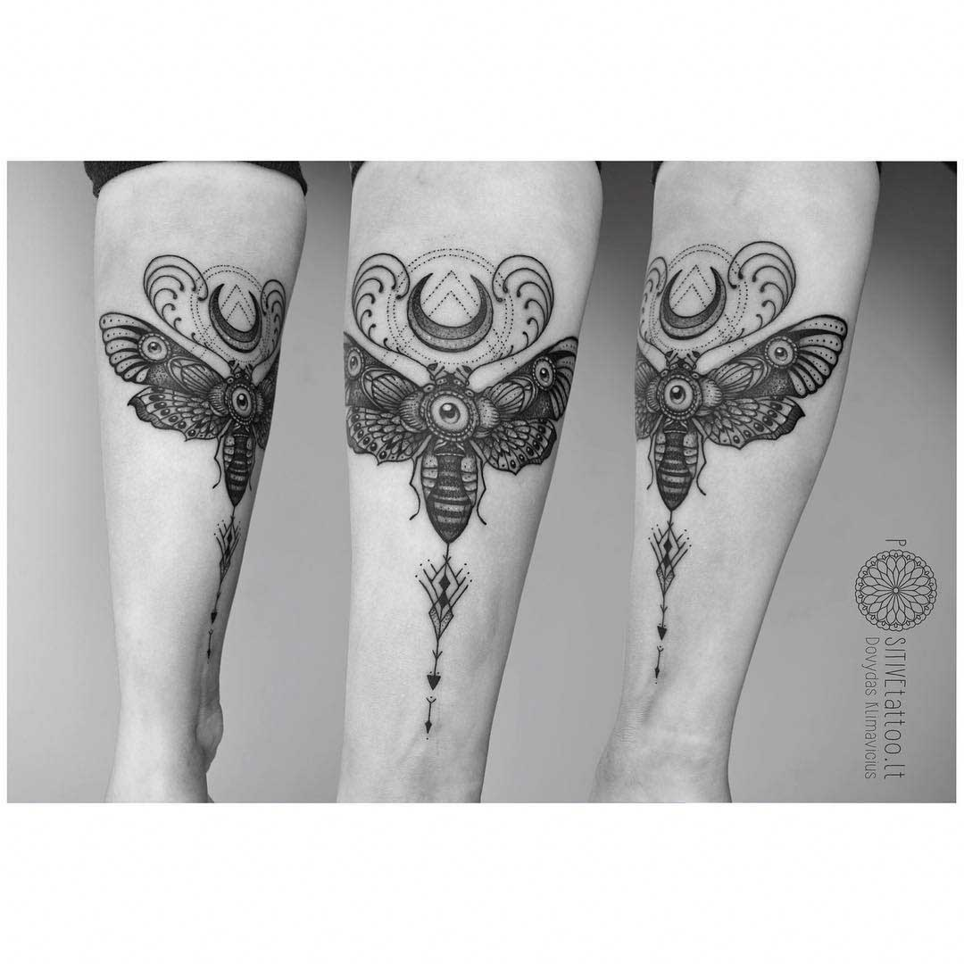 moth tattoo with moon on arm