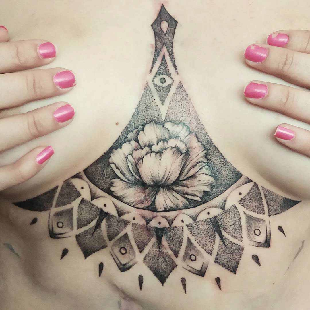 flower tattoo under breast