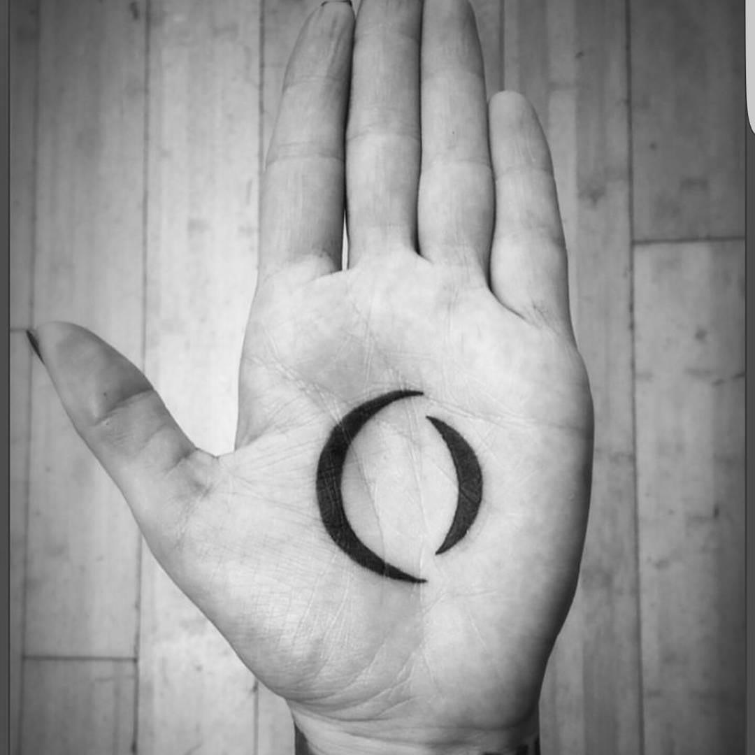 black simple tattoo on palm