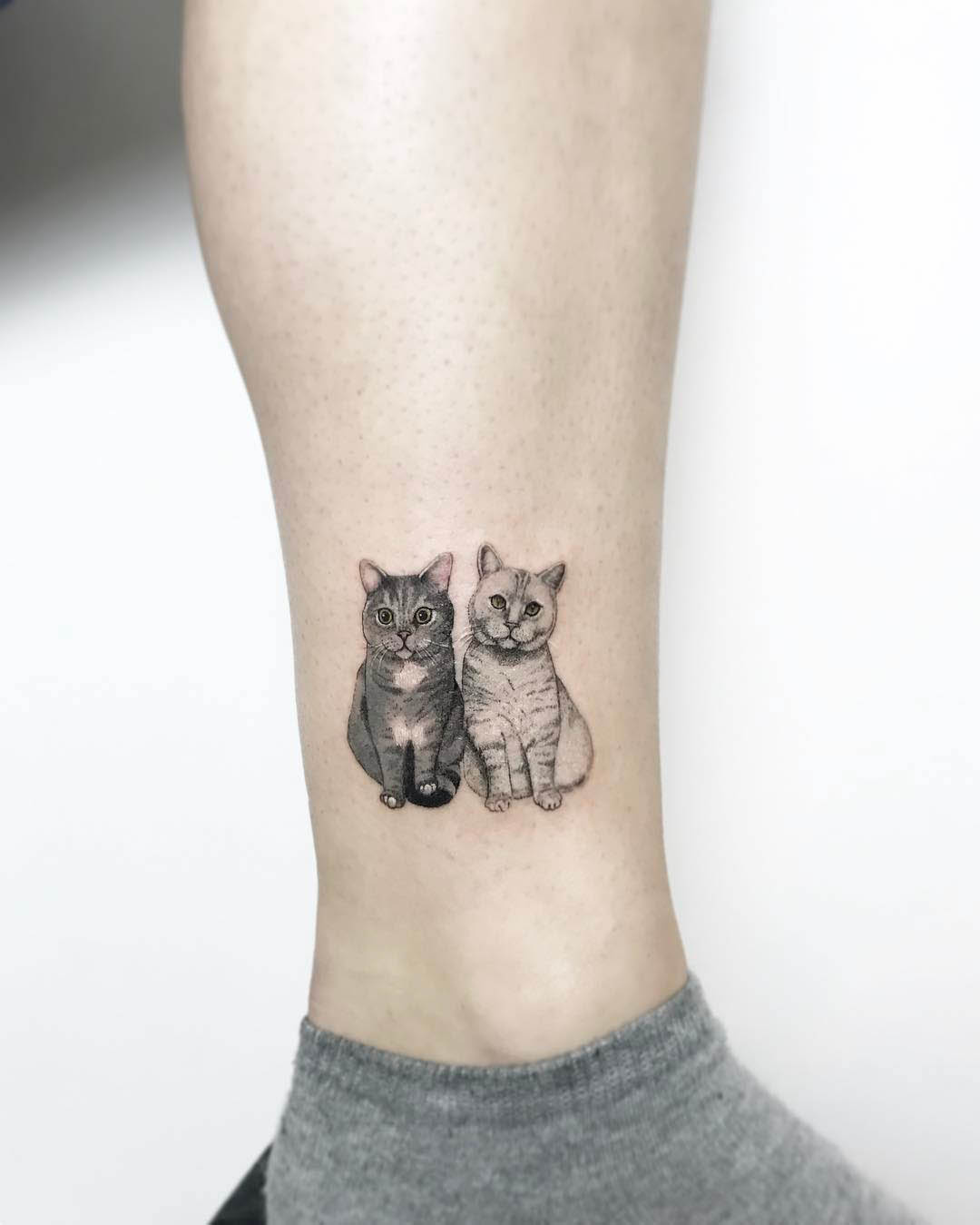 Small cats tattoo on ankle