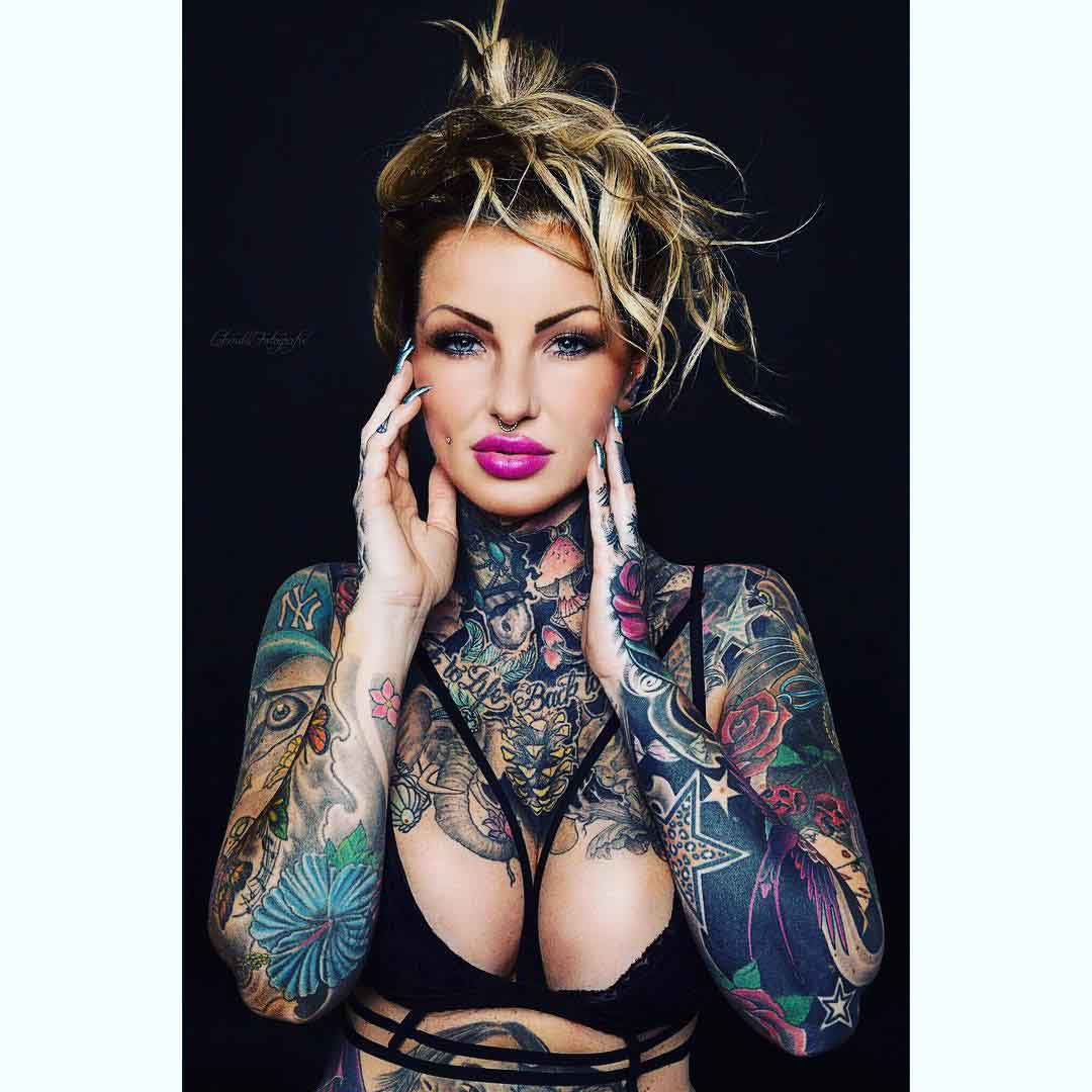 a lot of tattoos on girl