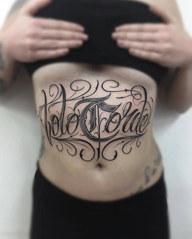 chicano tattoo lettering on stomach