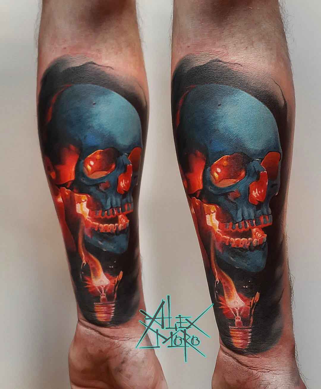 skull tatto on arm and lightbulb