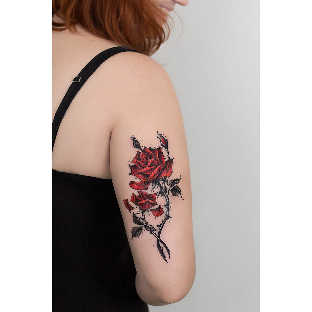 back arm tattoo red rose