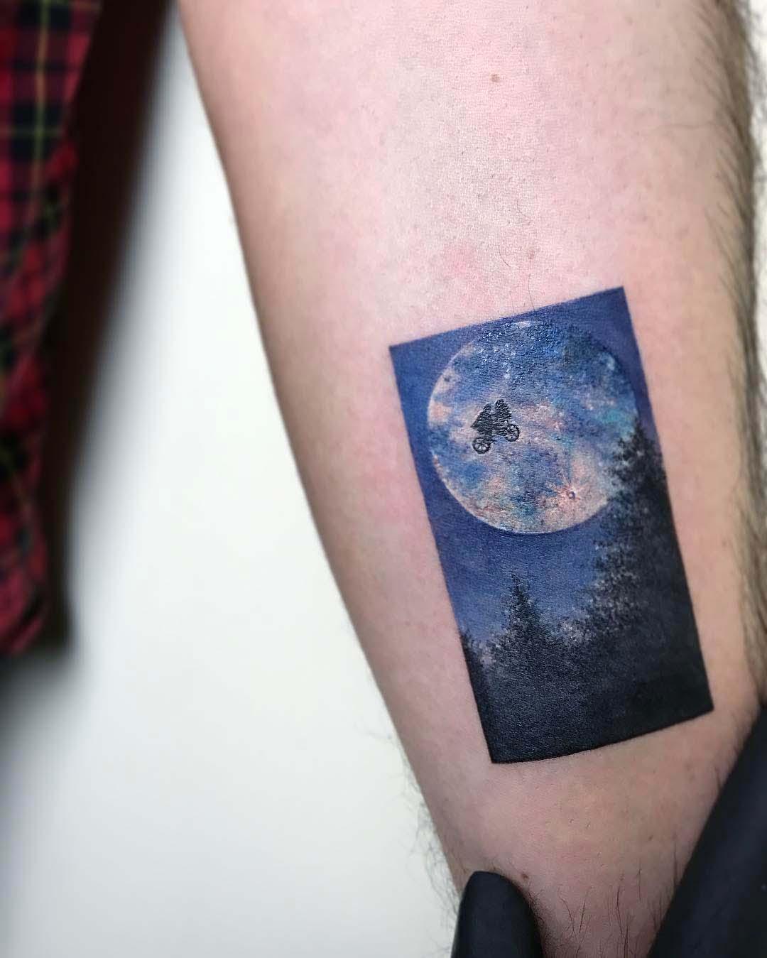 arm tattoo ET scene