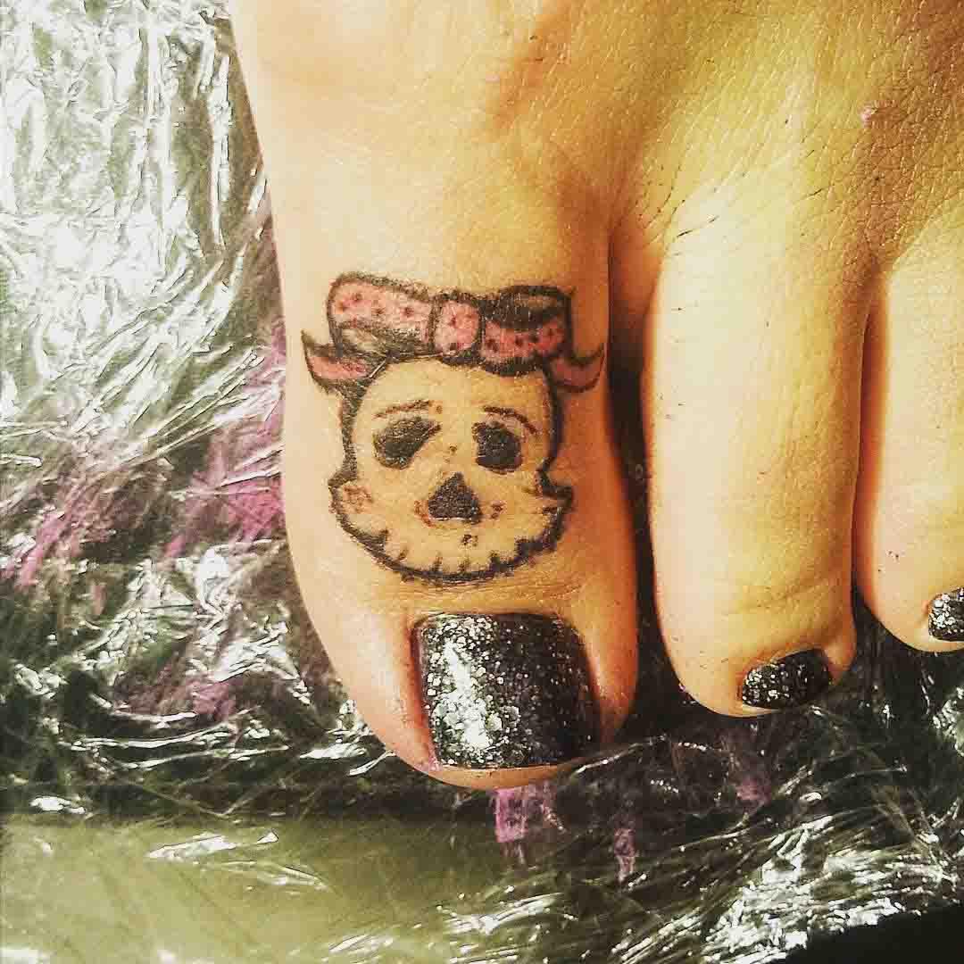 Girl Skull Tattoo on Toe by Gold Star Tattoo