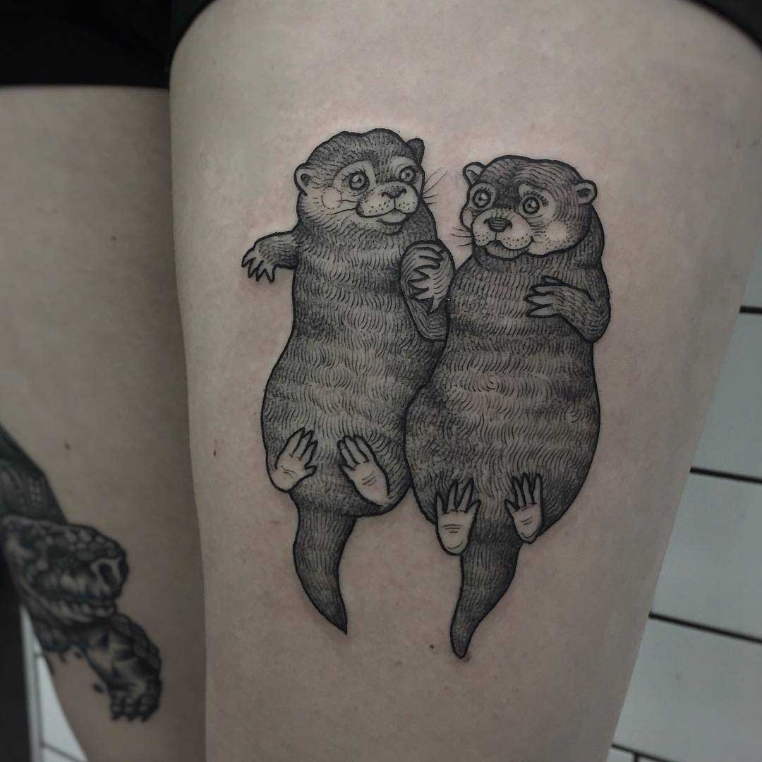 otters tattoo holding hands