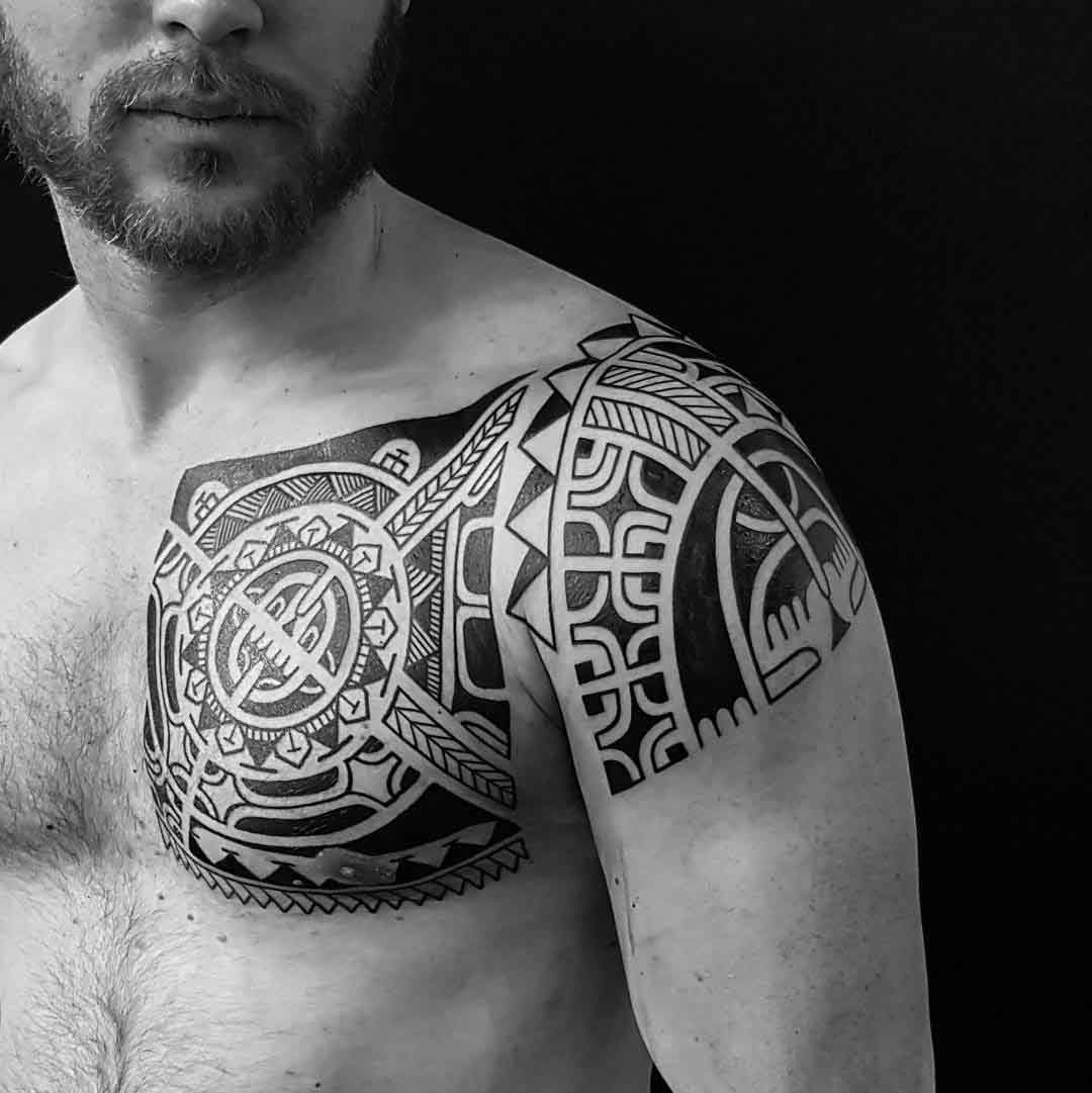 chest to shoulder polynesian tattoo