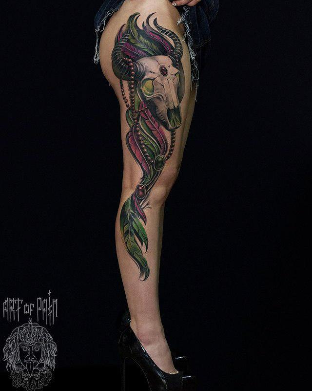 bull skull tattoo on full leg side