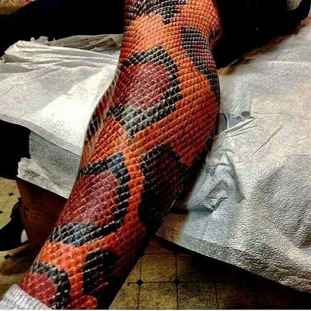 snake skin tattoo on leg