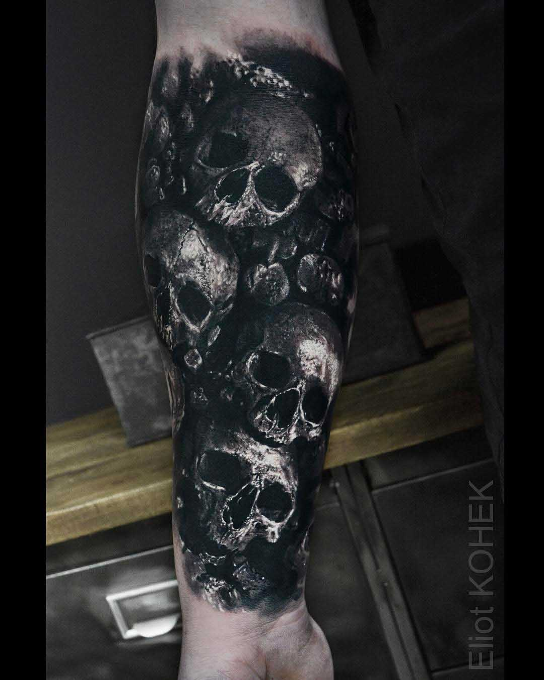 a lot of skulls tattoo on arm