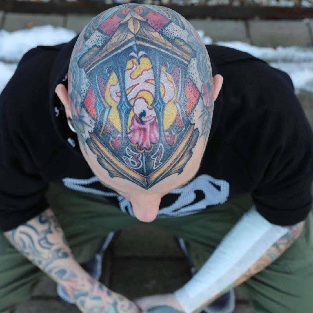 bald head tattoo