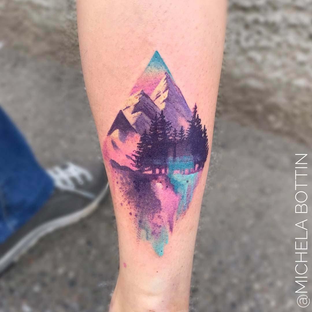 mountain watercolor tattoo on calf