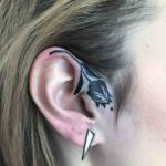 Black Rose Tattoo on Ear