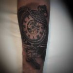 Clock and Crucifix Tattoo on Arm