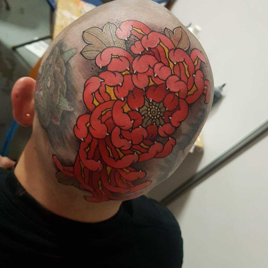 head tattoo red flower