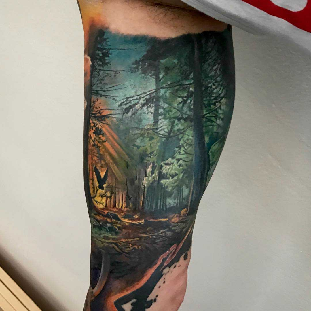 bicep tattoo forest realistic