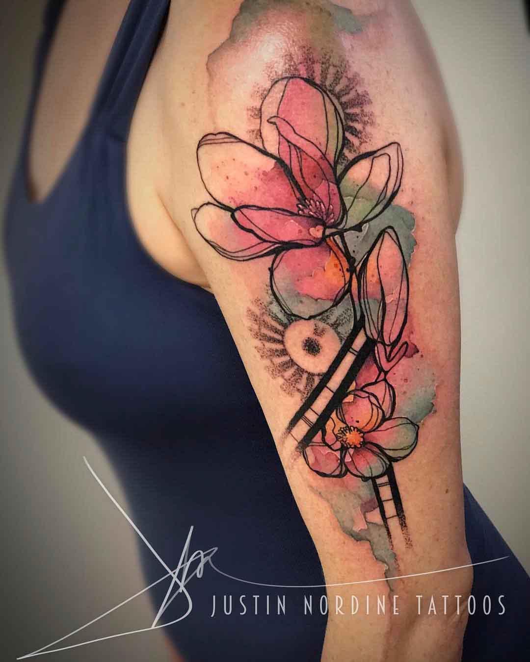 watercolor mgnolia tattoo on shoulder