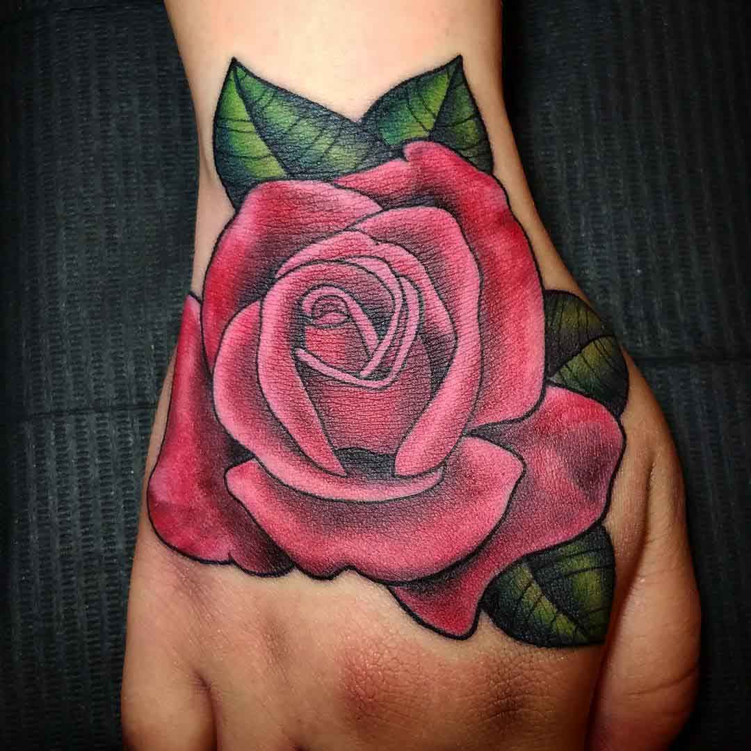 pink rose tattoo on hand