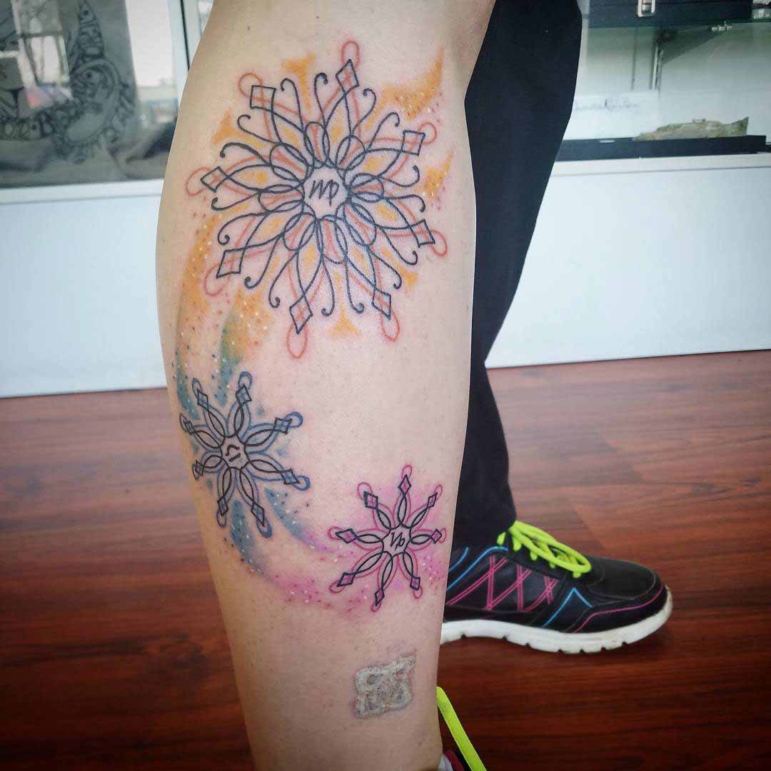 side lge tattoo snowflakes