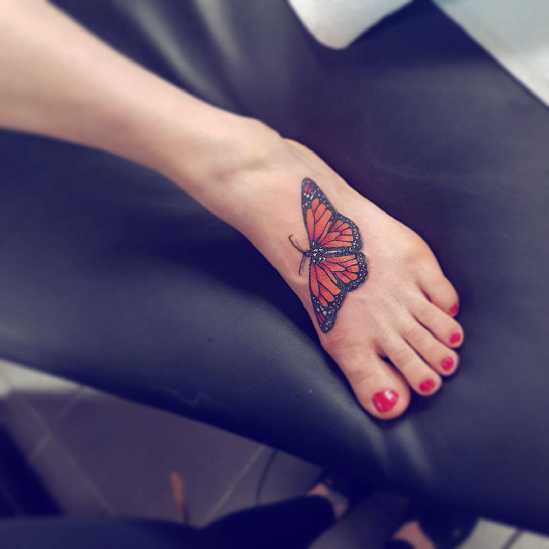 foot butterfly tattoo