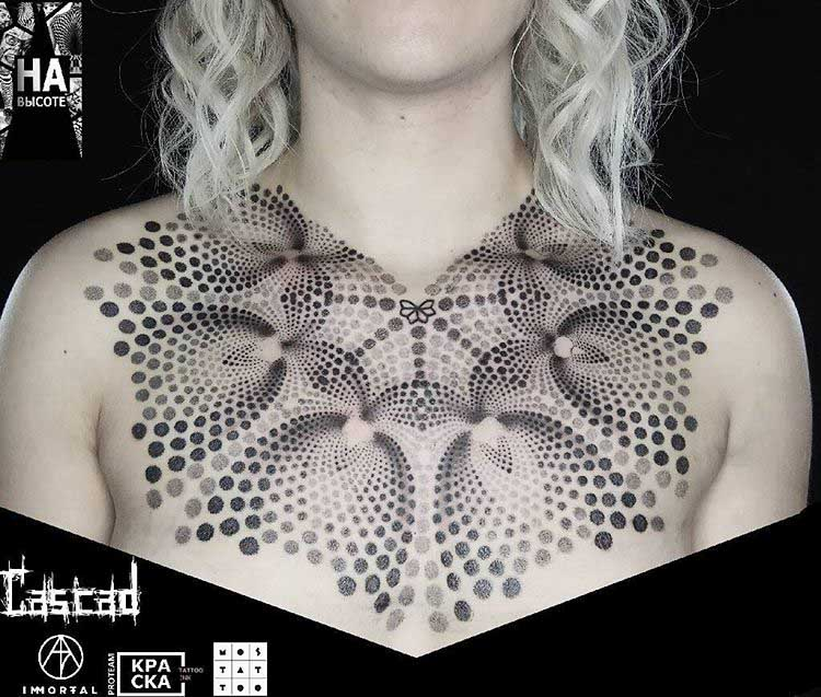 dotwork tattoo on chest and collar bone