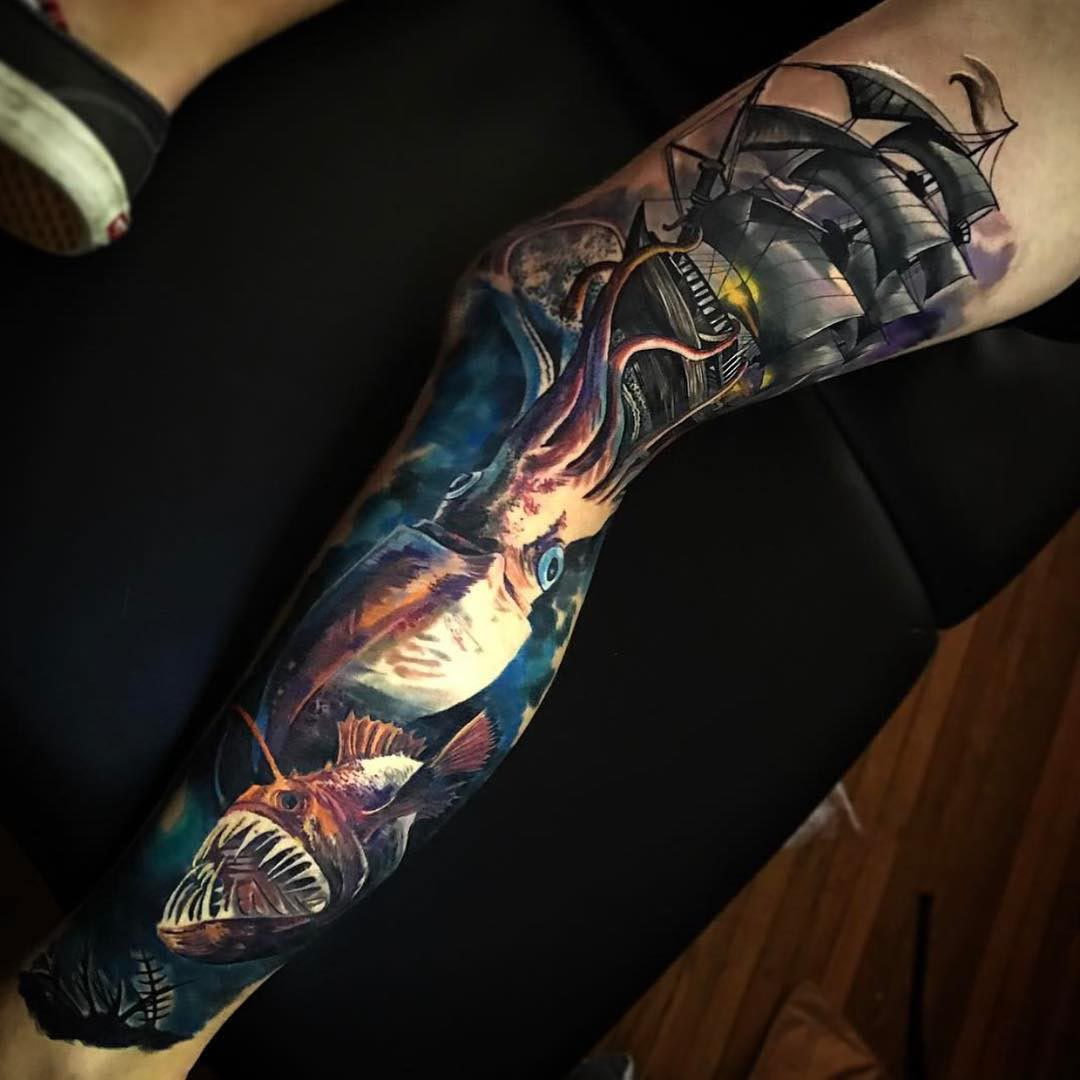realistic nautical tattoo on leg sleeve