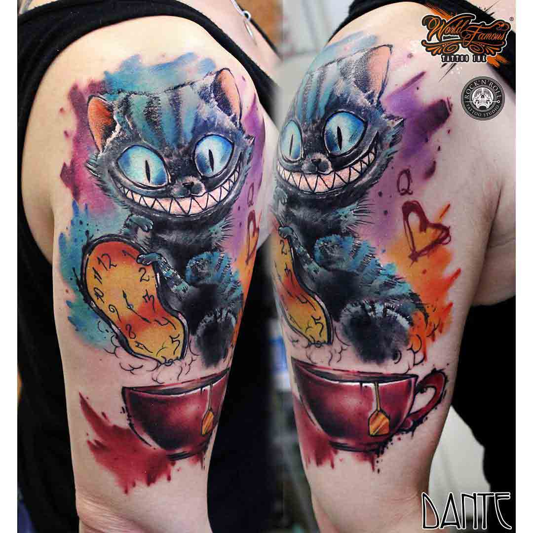 shoulder tattoo watercolor cheshire cat