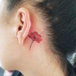 Poppy Flower Tattoo Behind Ear