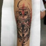 Owl and Wolf Tattoo on Arm