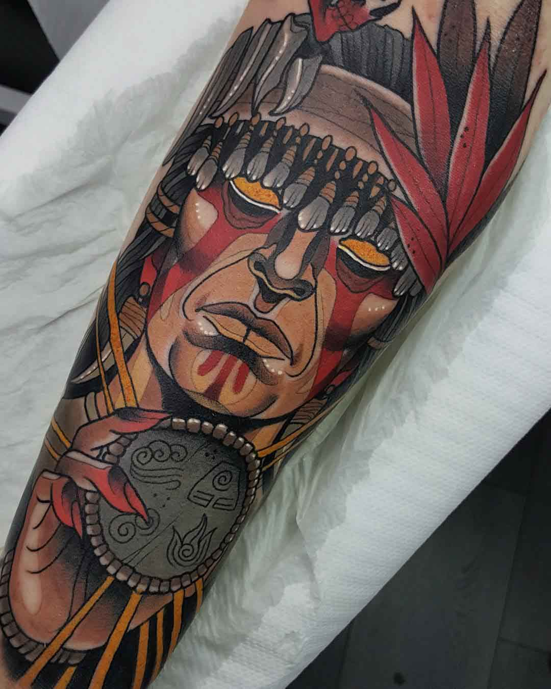 arm tattoo shaman face